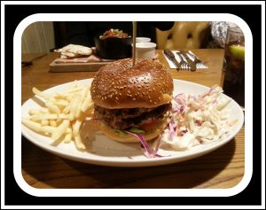Double 1/4 lb burger with skinny fries and slaw from the early menu that finishes around 6.30pm